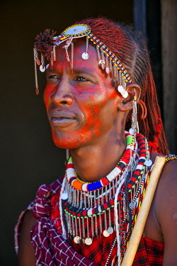 Africa, Kenya, Narok County, Masai Mara. Maasai Man dressed in traditional attire.