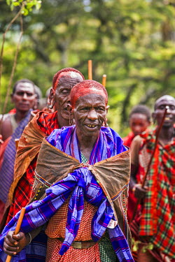 KEN9141AW Africa, Kenya, Narok County, Masai Mara. Masai elders dressed in traditional attire at their homestead, preparing for one of their customary ceremonies.