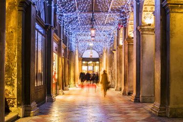 ITA3564AW Italy, Veneto, Venice. St Marks square's colonnade, decorated with Christmas lights