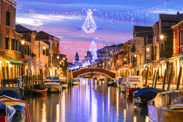 ITA3567AW Italy, Veneto, Venice, Murano island. Canal at sunset with Christmas lights hanging