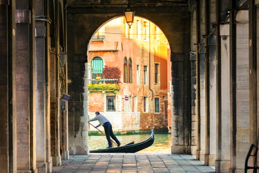 ITA3568AW Italy, Veneto, Venice. Gondola passing on Grand canal seen from a colonnade