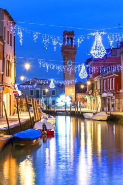ITA3616AW Italy, Veneto, Venice, Murano island. Canal at dusk with Christmas lights hanging