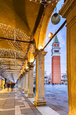 ITA3573AW Italy, Veneto, Venice. Under St Marks square's colonnade, decorated with Christmas lights