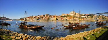 POR8166AW Oporto, capital of the Port wine, and the Ribeira district, UNESCO World Heritage Site. In the foreground the Rabelos boats, Portugal
