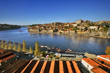 POR8167AW Oporto, capital of the Port wine, and the Ribeira district, UNESCO World Heritage Site. In the foreground the Rabelos boats and the Port wine cellars of Vila Nova de Gaia, Portugal