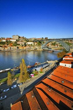 POR8168AW Oporto, capital of the Port wine, and the Ribeira district, UNESCO World Heritage Site. In the foreground the Rabelos boats and the Port wine cellars of Vila Nova de Gaia, Portugal