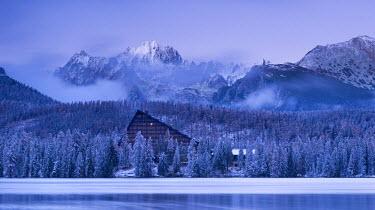 SLV1291AW Strbske Pleso lake and mountains in winter snowfall, High Tatras, Slovakia, Europe.  November