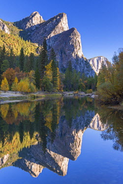 USA9412AW The Three Brothers reflected in the Merced River at dawn, Yosemite Valley, California, USA. Autumn (October)