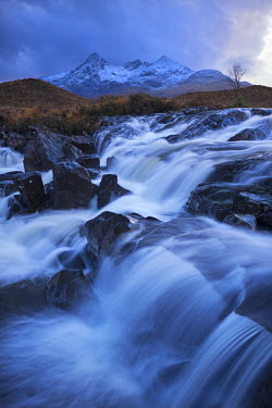 SCO33343AW Waterfall on the River Sligachan with Sgurr nan Gillean mountain in the background, Isle of Skye, Scotland. Winter (November)