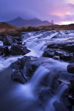 SCO33350AW The river Allt Dearg Mor tumbling over a series of waterfalls in Glen Sligachan, Isle of Skye, Scotland. Winter (November)