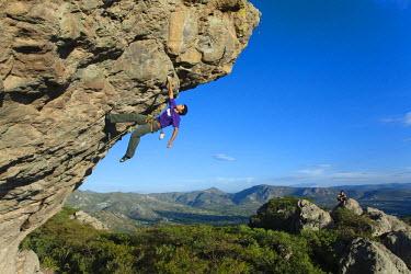 "AR5041700041 Mexican rock climber Mauricio Huerta wearing a purple shirt tryes ""El Jibaro"" (5.13c) in Hidalgo, Mexico."