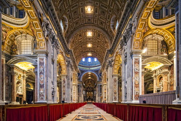 ITA3724 View of the nave in the Basilica of St. Peters looking towards the Altar, Vatican City, The Vatican.