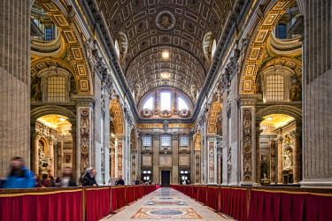 ITA3725 View of the nave in the Basilica of St. Peters looking towards the main entrance, Vatican City, The Vatican.