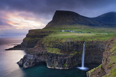 DEN0109AW Dramatic coastal scenery at Gasadalur on the island of Vagar, Faroe Islands. Spring