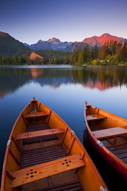 SLV1300AW Wooden boats on Strbske Pleso lake in the Tatra Mountains of Slovakia, Europe. Autumn
