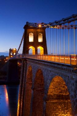 WAL7439AW Evening illuminations on the Menai Bridge spanning the Menai Strait, North Wales, UK. Spring