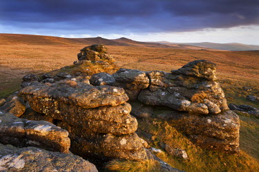 ENG12038AW Evening sunlight on Arms Tor, looking towards Chat Tor and Hare Tor, Dartmoor, Devon, England. Spring