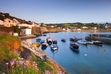 ENG12127AW Pretty harbour and fishing boats at Coverack on the Lizard Peninsula, Cornwall, England. Spring