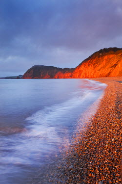 ENG12170AW Burning red cliffs at Sidmouth on the Jurassic Coast, Devon, England. Winter