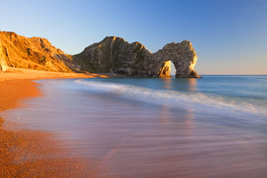 ENG12175AW Waves sweeping onto the deserted beach at Durdle Door, Dorset, England. Winter