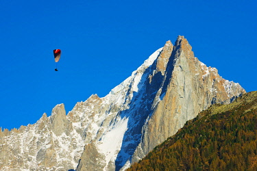 FRA8521 Europe, France, Haute Savoie, Rhone Alps, Chamonix Valley, paraglider below Les Drus and Aiguille Verte