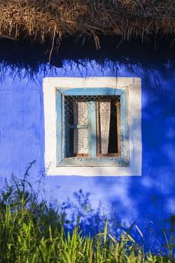 RM01476 Romania, Maramures Region, Baia Mare, outdoor village life exhibit, traditional house detail