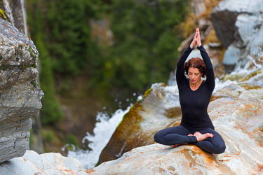 Europe, France, Haute Savoie, Rhone Alps, Chamonix, Berard valley, Cascade du Berard, girl doing yoga (MR)