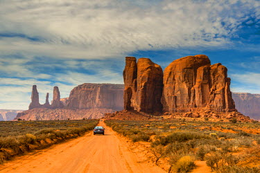 Unpaved road with scenic desert landscape, Monument Valley Navajo Tribal Park, Arizona, USA