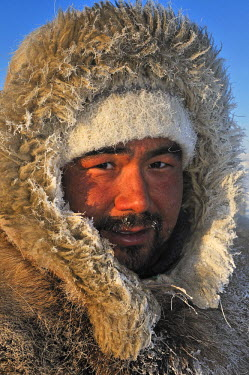 Dog Sled leader with a anorak made of dog fur, Ilulissat, Greenland