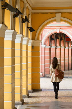 CH10434AW Woman walking along walkway in Senado Square, Macau, China (MR)