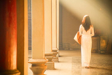 VIT0682AW Woman wearing ao dai dress at Thien Hau Pagoda, Cholon, Ho Chi Minh City, Vietnam (MR)