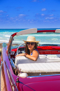 CB01676 Young woman and a 1959 Dodge Custom Loyal Lancer Convertible, Playa del Este, Havana, Cuba (MR)