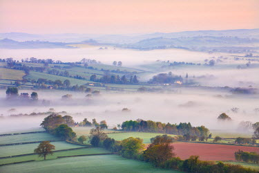 WAL7444AW Mist covered countryside at dawn near Pennorth, Brecon Beacons National Park, Powys, Wales. Spring