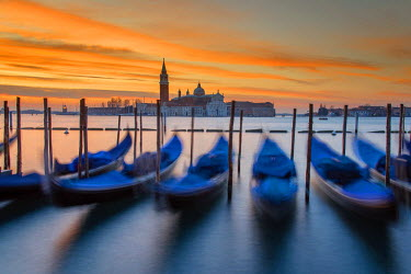 ITA4078AW Moored gondolas with San Giorgio Maggiore island in the background at sunrise, Venice, Veneto, Italy