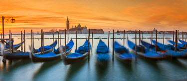 ITA4091AW Moored gondolas with San Giorgio Maggiore island in the background at sunrise, Venice, Veneto, Italy