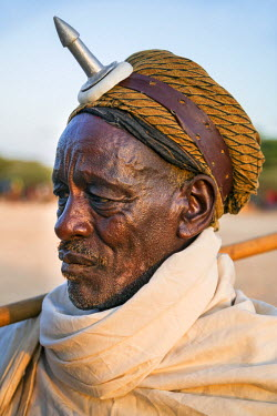 KEN9303 Kenya, Marsabit County, Kalacha.  An old Borana man wearing a phallic on his forehead. They are known as kalach and are used by men of both the Borana and Gabbra  communities on special occasions.