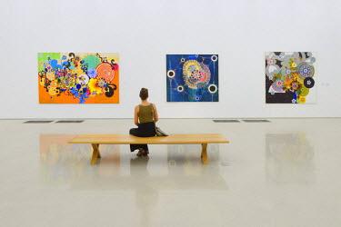 USA9621AW USA,Florida,Dade County,Miami, PAMM, Perez Art Museum of Miami, woman sitting on Perez Art Museum exhibition