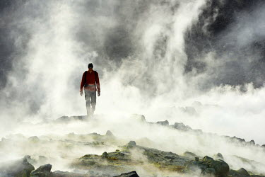 Hiker on the Gran craters walks through Steam, Vulcano Island, Aeolian, or Aeolian Islands, Sicily, Italy, Europe, MR