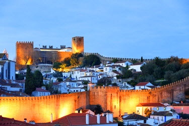 POR8246AW Obidos at dusk, one of the most beautiful medieval villages in Portugal, taken to the moors in the 12th century.