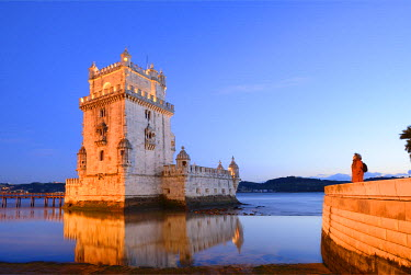 POR8256AW Torre de Belem (Belem Tower), a UNESCO World Heritage Site built in the 16th century in Portuguese Manueline Style at twilight. It was designed by the architect Francisco de Arruda. The River Tagus Es...