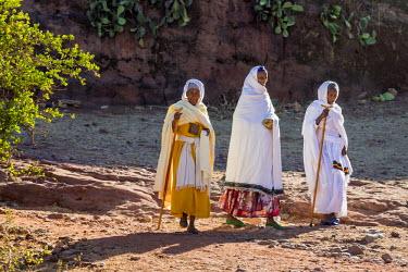 ETH2597 Ethiopia, Abraha Atsbeha, Tigray Region.  Old women return home after attending a service at the semi-monolithic 10th century church of Abraha Atsbeha.