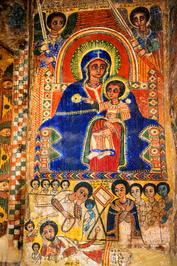 ETH2606 Ethiopia, Abraha Atsbeha, Tigray Region. The interior of the semi-monolithic 10th century church of Abraha Atsbeha is richly adorned with post-17th century paintings depicting biblical scenes.