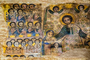 ETH2609 Ethiopia, Abraha Atsbeha, Tigray Region. The interior of the semi-monolithic 10th century church of Abraha Atsbeha is richly adorned with post-17th century paintings depicting biblical scenes.
