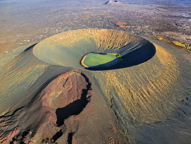 ETH2639 Ethiopia, Erta Ale range, Catherine, Afar Region. Surrounded by vast lava fields, Catherine or Catherina is a round volcanic tuff ring with a crater lake.  The blowhole on its side caused the newest l...