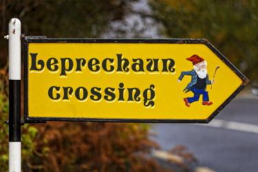 IRL0282 Leprechaun crossing warning sign at Ladies View, Derrycunnihy, Co. Kerry, Ireland.