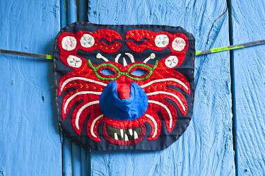 HMS0620620 Panama, San Blas archipelago, Kuna Yala autonomous territory, Carti island, molas (embroidered textiles) by the Kuna indian, mask