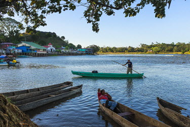 Nicaragua, Rio San Juan Department, the little village of El Castillo along the Rio San Juan, crossing the river with a local boat