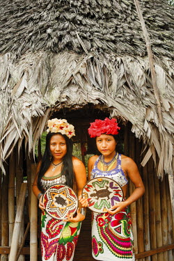 HMS2096953 Panama, Darien province, Darien National Park, listed as World Heritage by UNESCO, Embera indigenous community, portrait of two young indigenous Embera girls wearing crafts for visitors