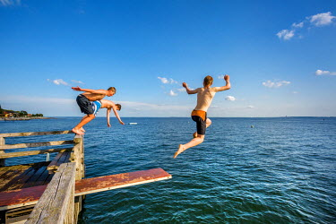 Boys jumping in the sea, Neustadt, Baltic coast, Schleswig-Holstein, Germany