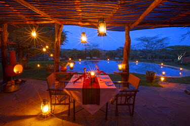 KEN9385 Kenya, Lewa Conservancy, Lewa Safari Camp. A romantic dinner set for two.